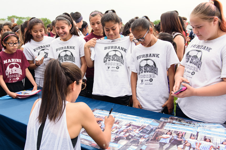 Christen Press signs autographs during an event with Good Sports - Good Sports donated soccer equipment to Chicago Public Schools on Saturday, June 3rd, 2017 at Hanson Stadium in Chicago